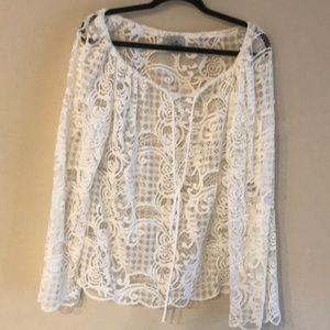 Bohemian bell sleeve lace like top.